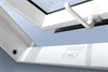 FAKRO white PVC centre pivot roof window open - Sterlingbuild