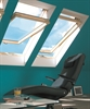 FAKRO pine obscure centre pivot roof window in room - Sterlingbuild