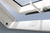 FAKRO white pvc obscure centre pivot roof window open - Sterlingbuild