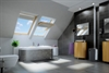 FAKRO secure pine enhanced security centre pivot roof window in bathroom - Sterlingbuild