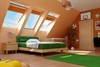 FAKRO secure pine enhanced security centre pivot roof window in bedroom - Sterlingbuild