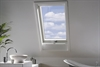 FAKRO white paint triple glazed centre pivot roof window in bathroom - Sterlingbuild
