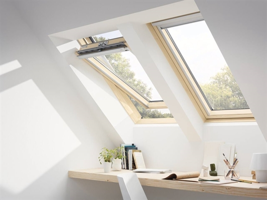 VELUX pine finish centre pivot roof windows installed