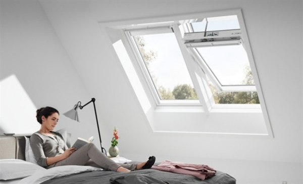 VELUX INTEGRA white roof windows installed in a bedroom