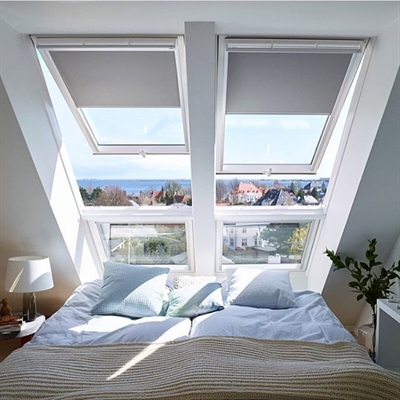 VELUX white top hung roof windows installed in a combination