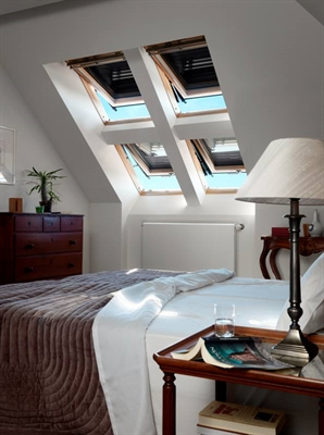 A combination of four pine top hung roof windows