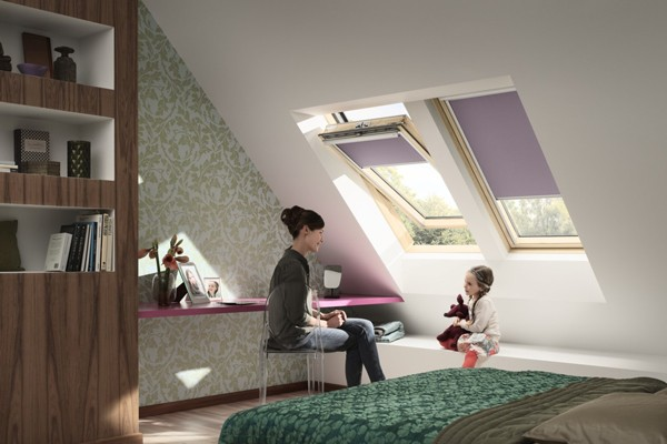 centre pivot roof window from VELUX with purple blinds