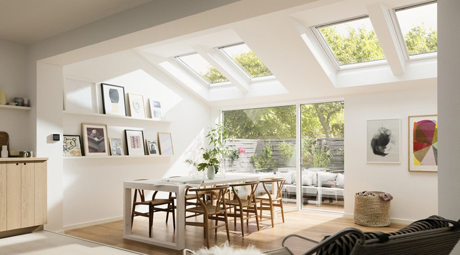 velux extension with four white roof windows