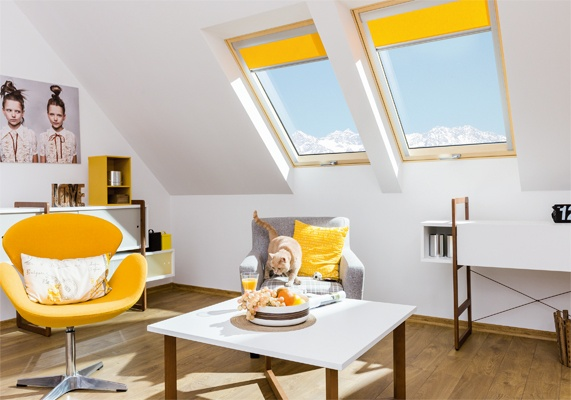 FAKRO noise reduction windows with yellow blinds in loft space