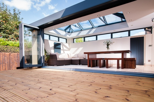 aluminium bifolds folded away with roof lantern