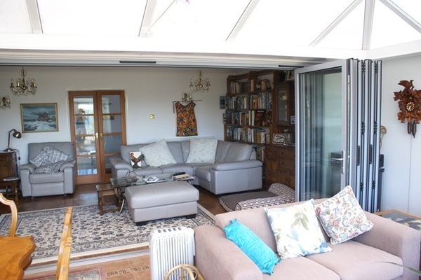 aluminium bifolds open connecting conservatory and lounge