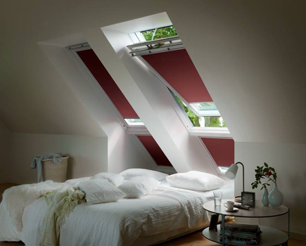 VELUX pitched roof windows with red blinds for loft conversions
