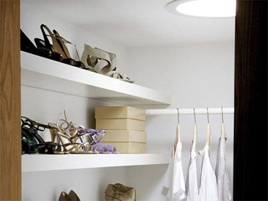 VELUX sun tunnels installed in dark store cupboard