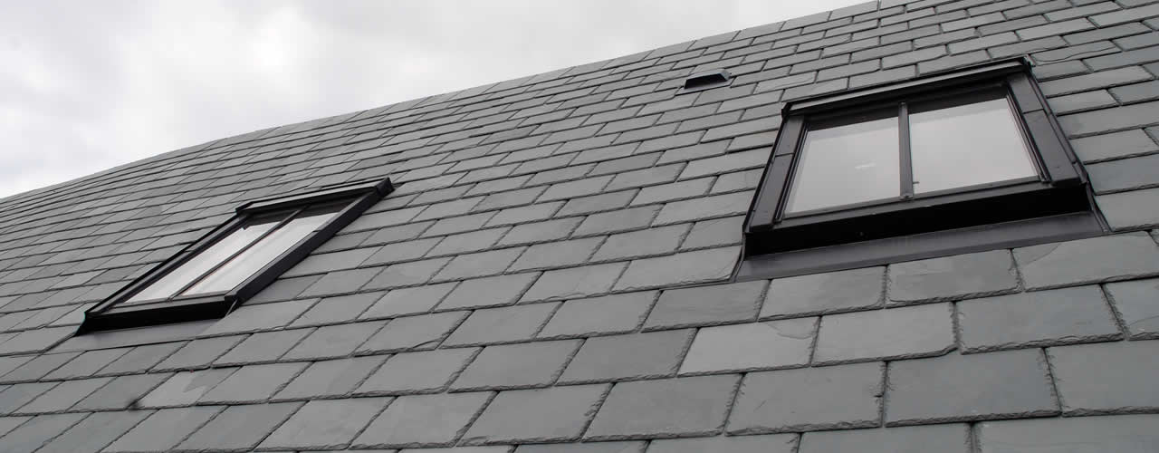 Conservation roof windows installed on a natural slate roof